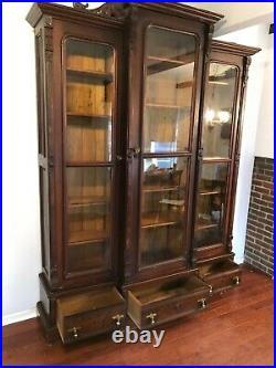 Victorian-eastlake Style Triple Door Walnut Bookcase